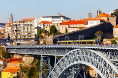 Bridge D. Luis I, Porto, Portugal. Closeup view of the centennial double-deck metal arch bridge over Douro river and yellow tram at Porto, Portugal. October 6 Stock Photography
