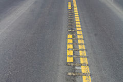 Closeup view of center rumble strips on a highway Royalty Free Stock Photography