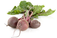 Closeup view of chard with three beetroots on white background Stock Photos
