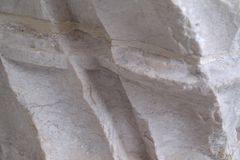 Closeup view of chiseled rock in old building facade. Lisbon royalty free stock photography