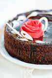 Chocolate cake with creamy pink rose Royalty Free Stock Photos