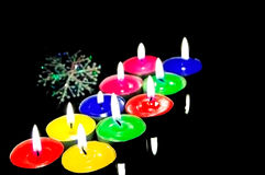 Closeup view of the christmas candles. Closeup view of the christmas candles cutting through the darkness Stock Photo