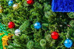 Closeup view of a Christmas tree decorated with glass balls Stock Images