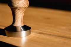 A closeup view of a coffee tamper royalty free stock photography