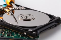 Closeup view of a computer hard disc in repair prosess. Closeup view of a computer hard disc in repair process Royalty Free Stock Photos