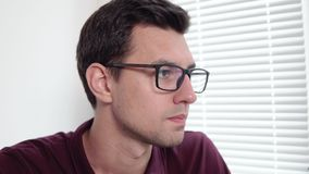 Closeup view of concentrated young businessman in glasses working at the office. Shot in 4k.  stock video