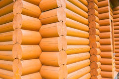 Closeup view of corner of wooden house made of natural logs Royalty Free Stock Images