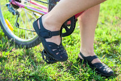 Closeup view of cyclist feet on pedals of bicycle Stock Photography