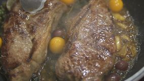 Closeup view of delicious beef steaks placed on hot grill. Closeup view of delicious beef steaks roasting with spices in the pan stock video