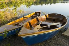 Dinghy Paddle Boat on Clear Water. Oar. Closeup View of Dinghy Paddle Boat on Clear Water. Oar stock image
