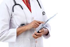Closeup view of doctor using tablet computer Stock Photography