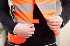 Closeup view of engineer with reflective vest. Getting ready for work Stock Photo