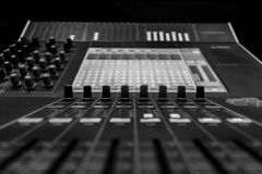 Closeup view of Faders on Professional digital Audio mixing control Console. Closeup of Pro Audio Digital Mixing Console. Black control Console with digital royalty free stock images