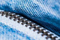 A closeup view of fastener of light blue jeans. Good visible texture and pattern stock photo