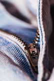 A closeup view of fastener of light blue jeans. Good visible texture and pattern stock image