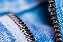 A closeup view of fastener of light blue jeans. Good visible texture and pattern stock images