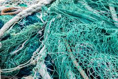 Fishing net. Closeup view at the fishing net on the boat royalty free stock photo