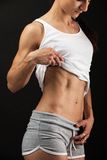 Closeup view of a fitness young woman over black Stock Photos