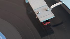 Vintage turntable closeup. Closeup view footage from above on playing vintage turntable stock video footage