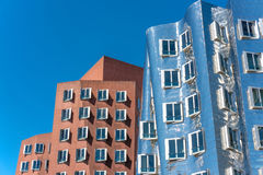 Closeup view of Frank Gehry`s famous modern buildings at Neuer Zollhof in Dusseldorf. Stock Images