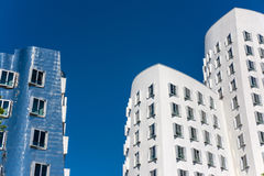 Closeup view of Frank Gehry& x27;s famous modern buildings at Neuer Zollhof in Dusseldorf. Royalty Free Stock Photos