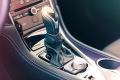 Gear stick with multimedia console. Closeup view of the gear stick with multimedia console in a luxury sport car Royalty Free Stock Images