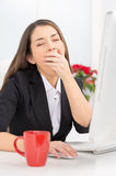 Closeup view of girl sitting at work. Royalty Free Stock Images