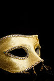 Closeup view of golden mask Stock Images