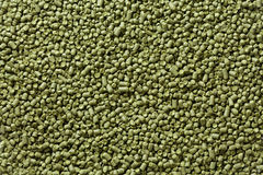 Closeup view of granule hop hopes. Ingredient for Industrial pro Royalty Free Stock Photo