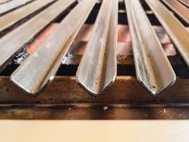 Closeup view of a grill for meat or steak where people cook their own food in a restaurant stock photo