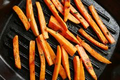 Closeup view of grill pan with sweet potato fries. Top view royalty free stock photos