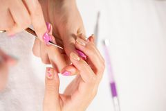 Closeup view of hands with manicure of young woman Nail treatment by a specialist in the salon stock image