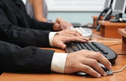 Closeup view of hands on a mouse and keyboard Stock Image