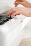 Closeup view of hands playing piano Royalty Free Stock Photos