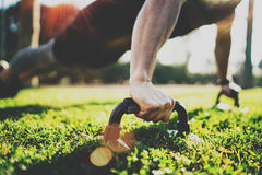 Closeup view of Handsome sport man doing pushups in the park on the sunny morning.Healthy lifestyle concept.Training Royalty Free Stock Photos