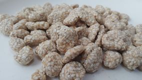 Closeup view of home made Asian sweet feed rewri or rewdi stock images