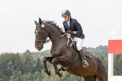 Closeup view of horsewoman jump Stock Photo