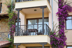 Closeup view of hotel balcony with bougainvillea flowers Stock Images
