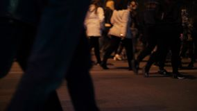 Closeup view of human feet people walking on crowded street movement stock video footage