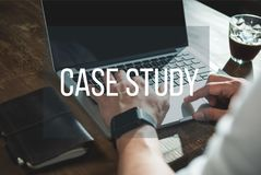 Man doing case study. Closeup view of human hands typing on laptop and sign case study royalty free stock image