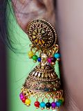 Indian woman ear hangings jewelry. Closeup view of Indian woman ear hangings jewelry ,traditional and custom royalty free stock images