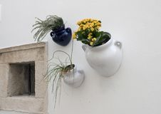 Closeup view of interesting ceramic wall plantars in Locorotondo, southern Italy. Pictured is a closeup view of small decorative ceramic wall planters  in Royalty Free Stock Photography