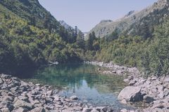 Closeup view of lake scenes in mountains, national park Dombay, Caucasus. Russia, Europe. Sunshine weather, blue color sky, far away green trees. Colorful royalty free stock photography