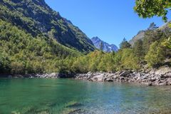 Closeup view of lake scenes in mountains, national park Dombay, Caucasus. Russia, Europe. Sunshine weather, blue color sky, far away green trees. Colorful royalty free stock images