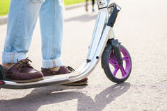 Closeup view with legs on scooter royalty free stock photos