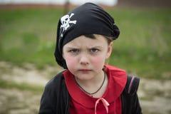Closeup view of little serious pirate girl portrait wearing black banadana Stock Image