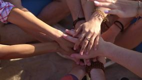 Closeup view of many hands together united in support. Teamwork and friendship concept. Slowmotion shot.  stock video footage