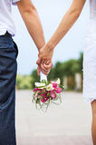 Closeup view of married couple holding hands Stock Photos
