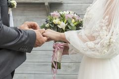 Closeup view of married couple holding hands. the guy and the girl are holding hands. love. bride and groom holding hands stock photo