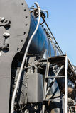 Closeup view of a mechanical equipment aroun a steam locomotive Stock Images